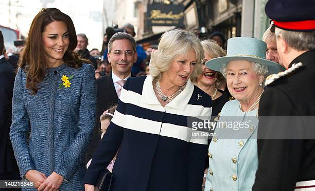 Catherine Duchess of Cambridge Camilla Duchess of Cornwall and Queen Elizabeth II depart after visiting the Fortnum And Mason Store on March 1 2012...