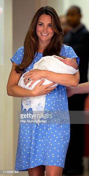 Catherine Duchess of Cambridge carries her newborn son as she and Prince William Duke of Cambridge leave The Lindo Wing at St Mary's Hospital on July...