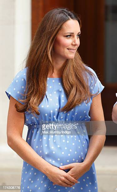 Catherine, Duchess of Cambridge carries her newborn son as she and Prince William, Duke of Cambridge leave The Lindo Wing at St Mary's Hospital on...
