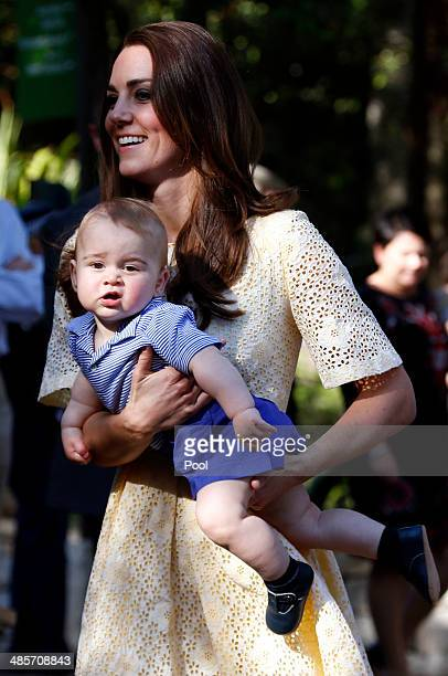 Catherine, Duchess of Cambridge carries her son Prince George of Cambridge as she walks towards the enclosure to see an Australian animal called a...