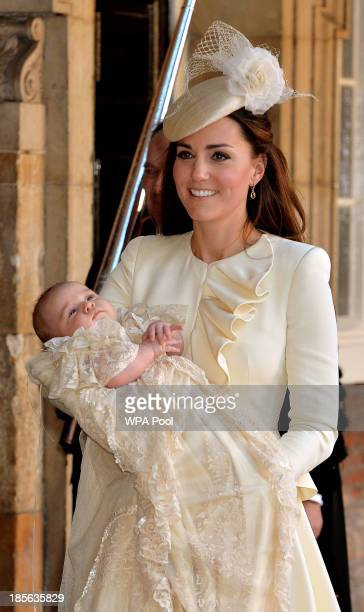 Catherine Duchess of Cambridge carries her son Prince George Of Cambridge after his christening at the Chapel Royal in St James's Palace on October...