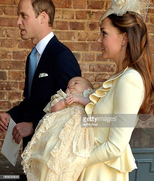 Catherine Duchess of Cambridge carries her son Prince George Of Cambridge alongside the Prince William Duke of Cambridge following his christening at...