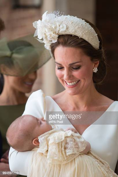 Catherine Duchess of Cambridge carries Prince Louis of Cambridge at his christening service at St James's Palace on July 09 2018 in London England