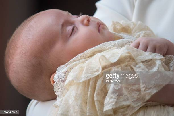 Catherine Duchess of Cambridge carries Prince Louis Of Cambridge as they arrive for his christening service at St James's Palace on July 09 2018 in...