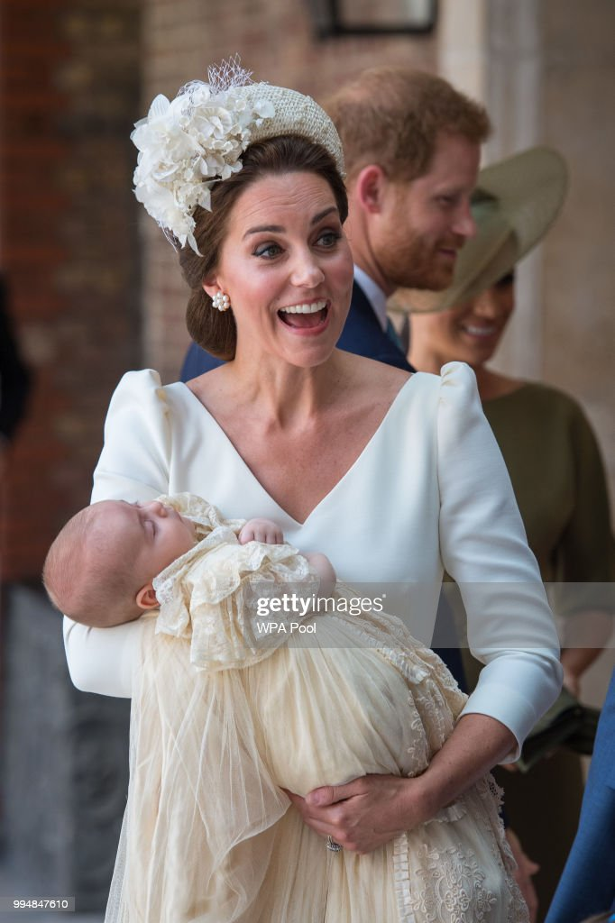 Catherine, Duchess of Cambridge carries Prince Louis of Cambridge at his christening service at St James's Palace on July 09, 2018 in London, England.