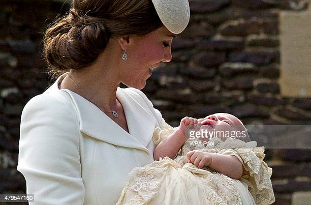Catherine, Duchess of Cambridge, carries Princess Charlotte of Cambridge as they arrive at the Church of St Mary Magdalene on the Sandringham Estate...