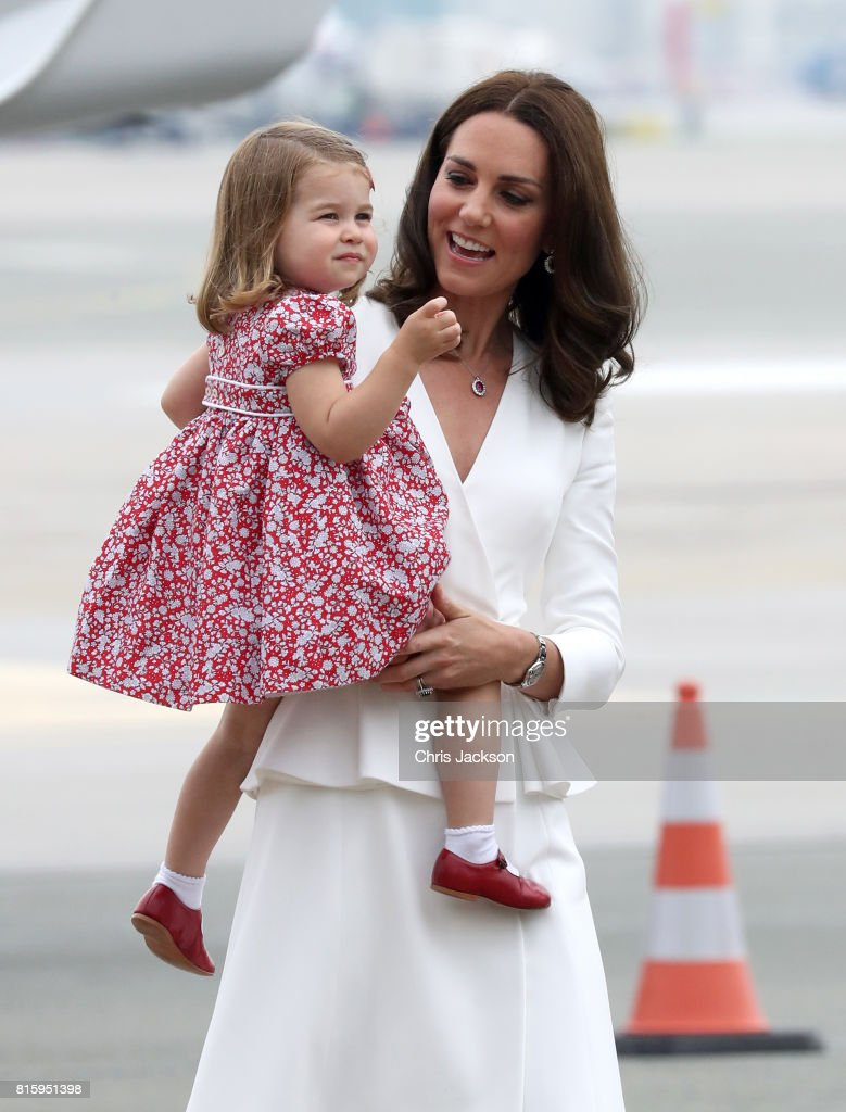 Catherine, Duchess of Cambridge carries Princess Charlotte of Cambridge as they arrive with Prince William, Duke of Cambridge and Prince George of Cambridge on day 1 of their official visit to Poland on July 17, 2017 in Warsaw, Poland.