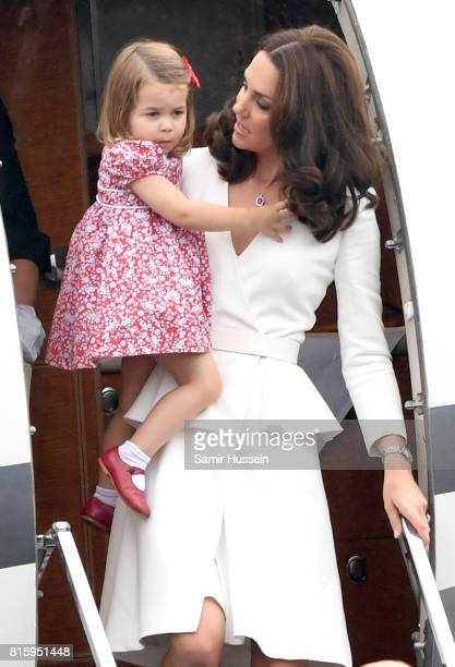 Catherine Duchess of Cambridge carries Princess Charlotte of Cambridge as they arrive with Prince William Duke of Cambridge and Prince George of...