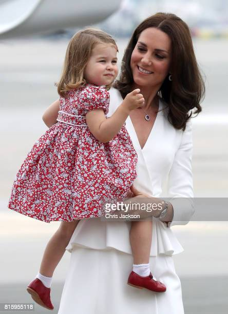 Catherine, Duchess of Cambridge carries Princess Charlotte of Cambridge as they arrive with Prince William, Duke of Cambridge and Prince George of...