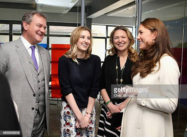 Catherine Duchess of Cambridge chats to Hugh Bonneville and Laura Carmichael during an official visit to the set of Downton Abbey at Ealing Studios...