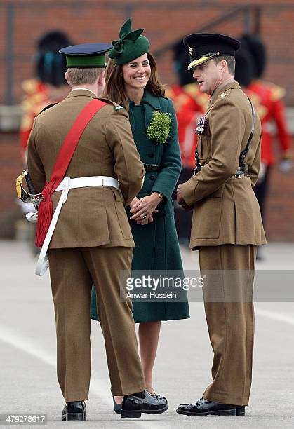 Catherine Duchess of Cambridge chats to soldiers during the St Patrick's Day Parade at Mons Barracks on March 17 2014 in Aldershot England