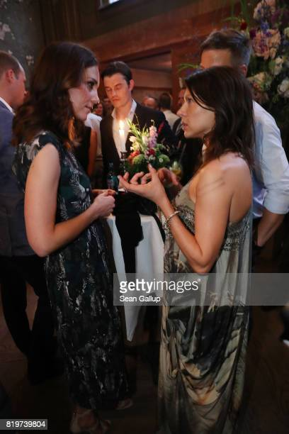 Catherine Duchess of Cambridge chats with German actress Jana Pallaske at a reception at Claerchen's Ballhaus dance hall following a day in...