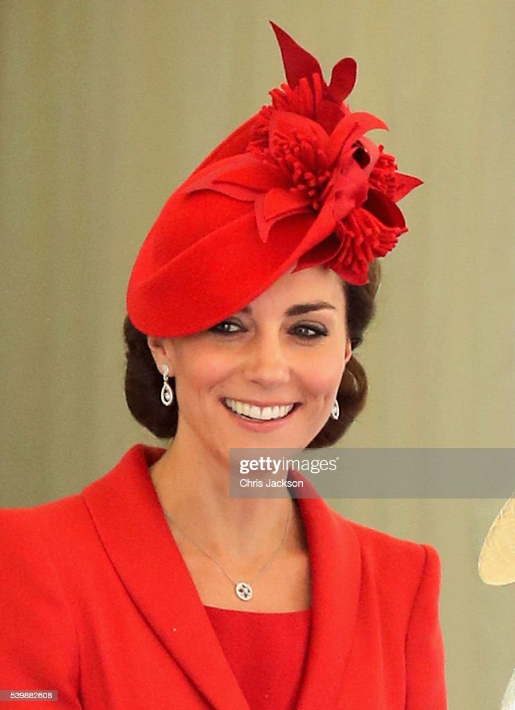 Catherine, Duchess of Cambridge chats with guests after the Order of the Garter Service at Windsor Castle on June 13, 2016 in Windsor, England. Today the traditional Garter parade was cancelled in favour of dignitaries arriving in cars due to the inclement weather.