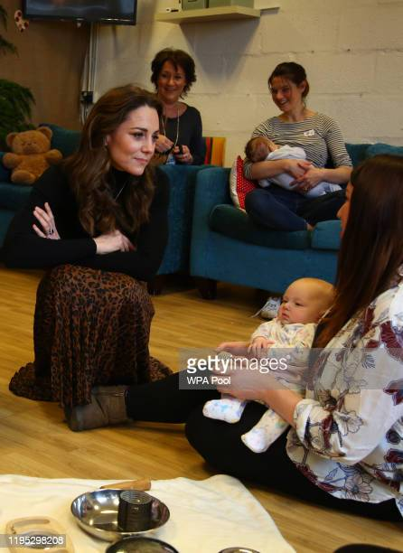 Catherine, Duchess of Cambridge chats with mothers and their children during a visit to Ely and Careau Children's Centre on January 22, 2020 in...