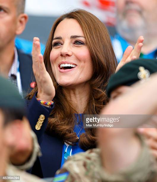 Catherine Duchess of Cambridge cheers as she watches the athletics at Hampden Park during the 20th Commonwealth Games on July 29 2014 in Glasgow...