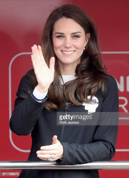 Catherine, Duchess of Cambridge cheers on runners as they signal the start of the 2017 Virgin Money London Marathon on April 23, 2017 in London,...