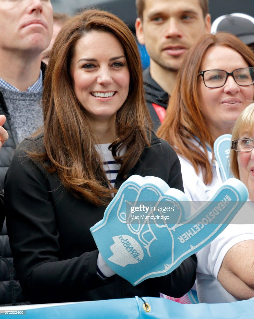 Catherine, Duchess of Cambridge (wearing a giant foam hand) cheers on runners talking part in the 2017 Virgin Money London Marathon on April 23, 2017 in London, England. The Heads Together mental heath campaign, spearheaded by The Duke & Duchess of Cambridge and Prince Harry, is the marathon's 2017 Charity of the Year.