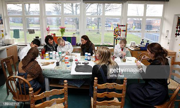 Catherine Duchess of Cambridge children with their painting while visiting The Art Room facilities at Rose Hill Primary School on February 21 2012 in...