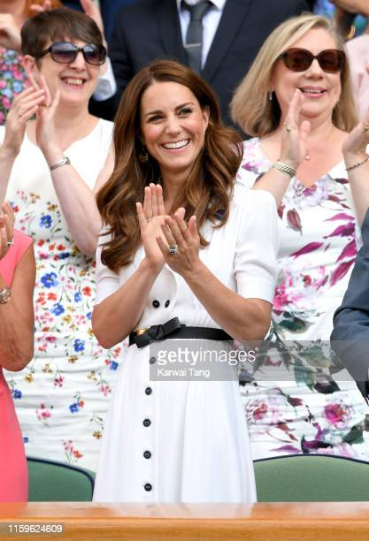 Catherine, Duchess of Cambridge claps as she attends day 2 of the Wimbledon Tennis Championships at the All England Lawn Tennis and Croquet Club on...