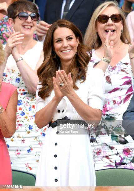 Catherine Duchess of Cambridge claps as she attends day 2 of the Wimbledon Tennis Championships at the All England Lawn Tennis and Croquet Club on...