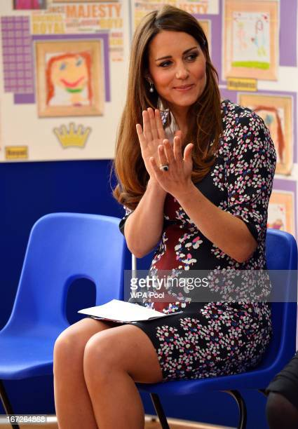 Catherine Duchess of Cambridge claps during her visit to The Willows Primary School Wythenshawe to launch a new school counseling program on April 23...