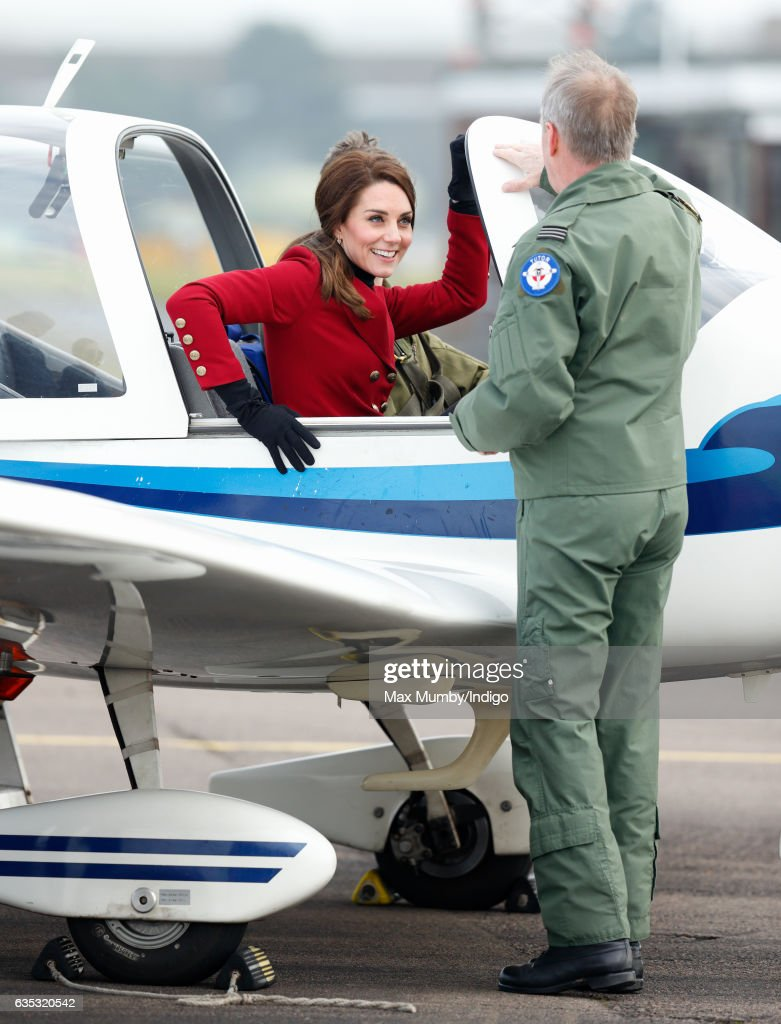 Catherine, Duchess of Cambridge climbs out of the cockpit of a Grob 115E 'Tutor' aeroplane during a visit to RAF Wittering to meet air cadets taking part in a half-term skills development camp on February 14, 2017 in Stamford, England. The Duchess of Cambridge is Royal Patron and Honorary Air Commandant of the Air Cadet Organisation.