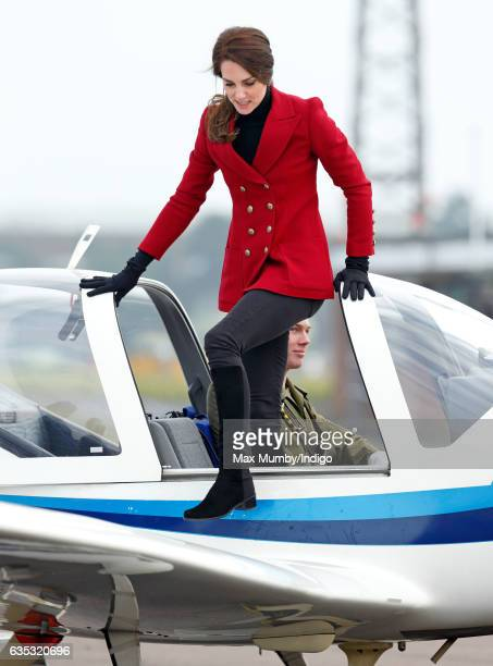 Catherine, Duchess of Cambridge climbs out of the cockpit of a Grob 115E 'Tutor' aeroplane during a visit to RAF Wittering to meet air cadets taking...