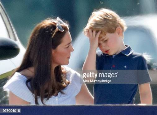 Catherine Duchess of Cambridge comforts Prince George of Cambridge as they attend the Maserati Royal Charity Polo Trophy at the Beaufort Polo Club on...