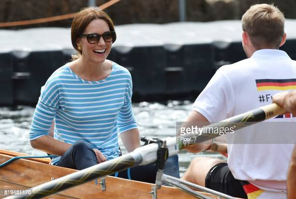 Catherine, Duchess of Cambridge competes against Prince William, Duke of Cambridge as they cox rowing boats in a friendly race between the twinned...