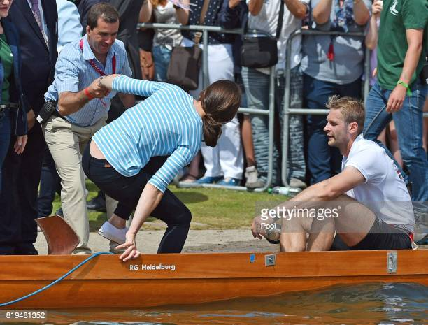 Catherine Duchess of Cambridge competes against Prince William Duke of Cambridge as they cox rowing boats in a friendly race between the twinned town...