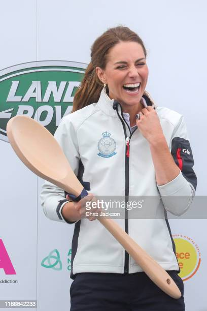 Catherine Duchess of Cambridge competing on behalf of The Royal Foundation is presented the Wooden Spoon at the inaugural King's Cup regatta prize...