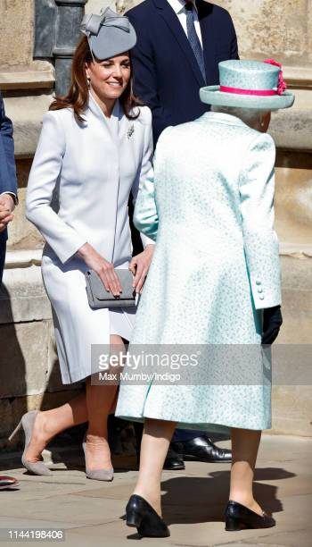 Catherine Duchess of Cambridge curtsies to Queen Elizabeth II as they attend the traditional Easter Sunday church service at St George's Chapel...