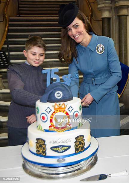 Catherine Duchess of Cambridge cuts a cake as she meets cadets during the 75th Anniversary of the RAF Air Cadets at St Clement Danes Church on...