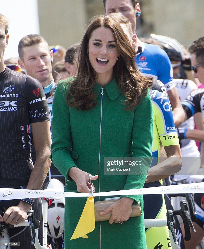 Catherine, Duchess of Cambridge cuts the ribbon to start stage stage one at the Grand Depart of The Tour de France at Harewood House on July 5, 2014 in Leeds, England.