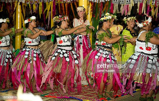 Catherine Duchess of Cambridge dances with local ladies at a Vaiku Falekaupule Ceremony during the Royal couple's Diamond Jubilee tour of the Far...
