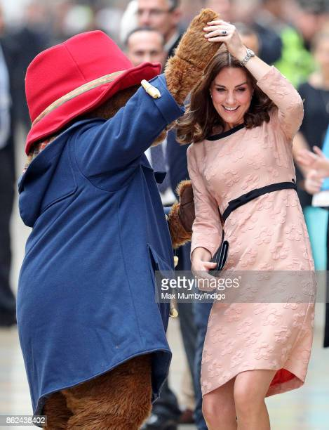 Catherine Duchess of Cambridge dances with Paddington Bear as she attends the Charities Forum Event at Paddington Station on October 16 2017 in...