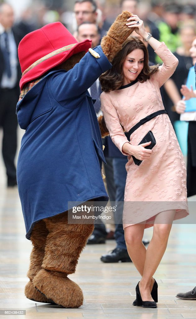 Catherine, Duchess of Cambridge dances with Paddington Bear as she attends the Charities Forum Event at Paddington Station on October 16, 2017 in London, England.