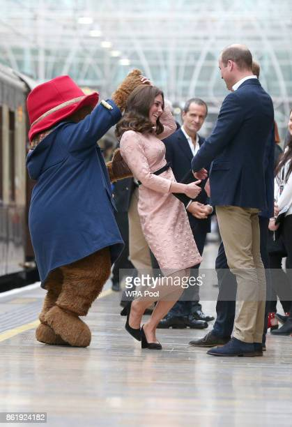 Catherine Duchess of Cambridge dances with Paddington bear on platform 1 at Paddington Station as she meets the cast and crew from the forthcoming...