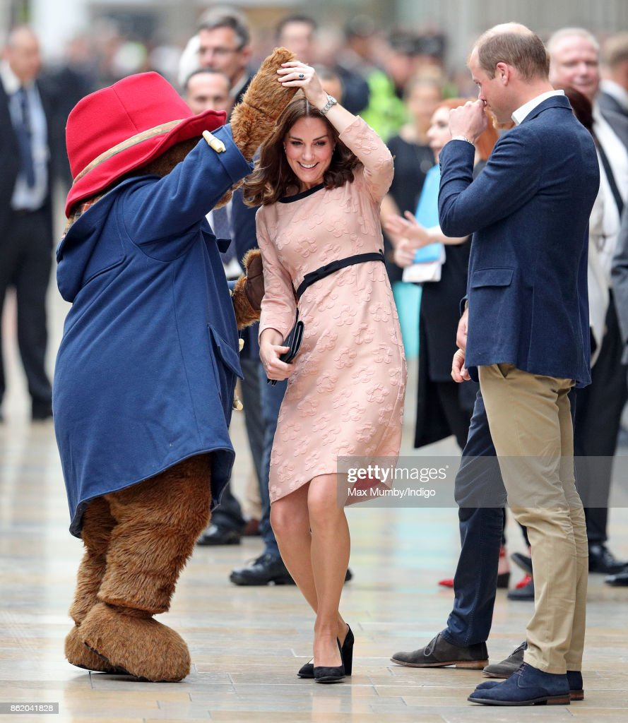 Catherine, Duchess of Cambridge dances with Paddington Bear, watched by Prince William, Duke of Cambridge and Prince Harry as they attend the Charities Forum Event at Paddington Station on October 16, 2017 in London, England.