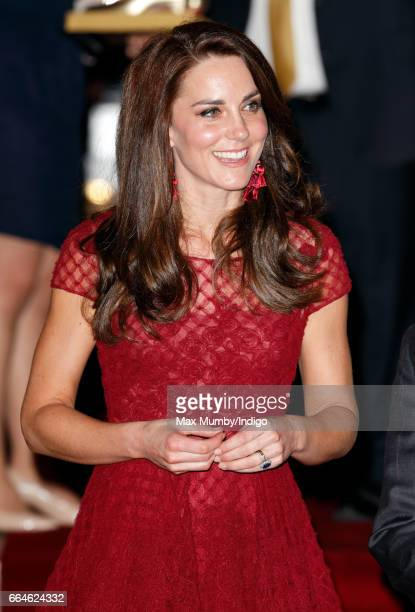 Catherine Duchess of Cambridge departs after attending the opening night of '42nd Street' at the Theatre Royal on April 4 2017 in London England The...