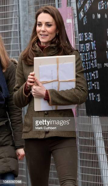 Catherine Duchess of Cambridge departs after visiting the Islington Community Garden to see how the project brings people together through gardening...