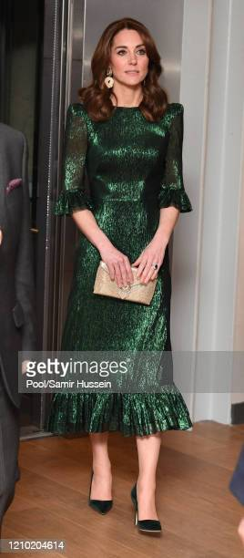 Catherine, Duchess of Cambridge drinks a Guinness at a reception hosted by the British Ambassador to Ireland Robin Barnett at the Guinness...