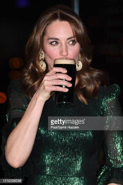 Catherine Duchess of Cambridge drinks a Guinness at a reception hosted by the British Ambassador to Ireland Robin Barnett at the Guinness...