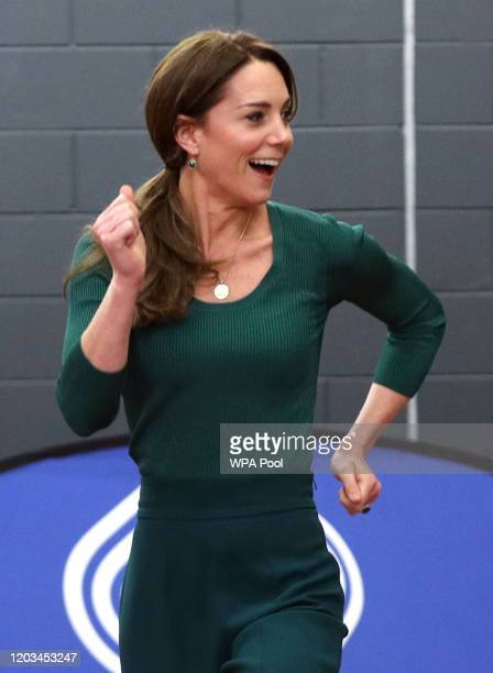 Catherine Duchess of Cambridge during a short race against paraathlete sprinter Emmanuel OyinboCoker and heptathlete Jessica EnnisHill during a...