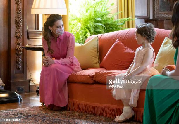 Catherine, Duchess of Cambridge during her meeting with Mila Sneddon, aged five, and her family, at the Palace of Holyroodhouse on May 27, 2021 in...