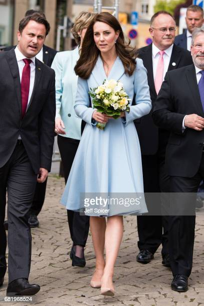 Catherine Duchess of Cambridge escorted by Xavier Bettel Prime Minister of Luxembourg tours a cycling themed festival and unveils a mural of British...