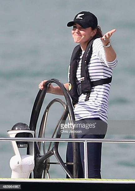 Catherine, Duchess of Cambridge gestures to Prince William, Duke of Cambridge as she helms an America's Cup yacht as she races Prince William, Duke...