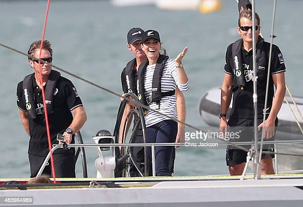 Catherine Duchess of Cambridge gestures to Prince William Duke of Cambridge as she helms an America's Cup yacht as she races Prince William Duke of...