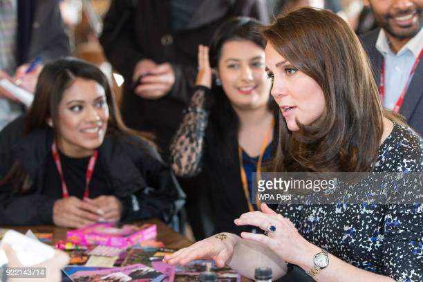 Catherine Duchess of Cambridge gets a henna tattoo during a visit to The Fire Station one of Sunderland's most iconic buildings recently converted...