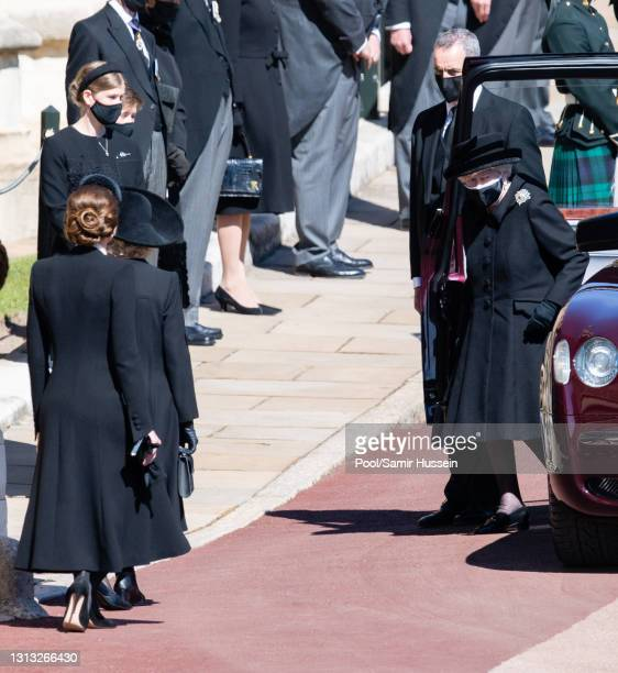 Catherine, Duchess of Cambridge gives a curtsy to Queen Elizabeth II during the funeral of Prince Philip, Duke of Edinburgh on April 17, 2021 in...
